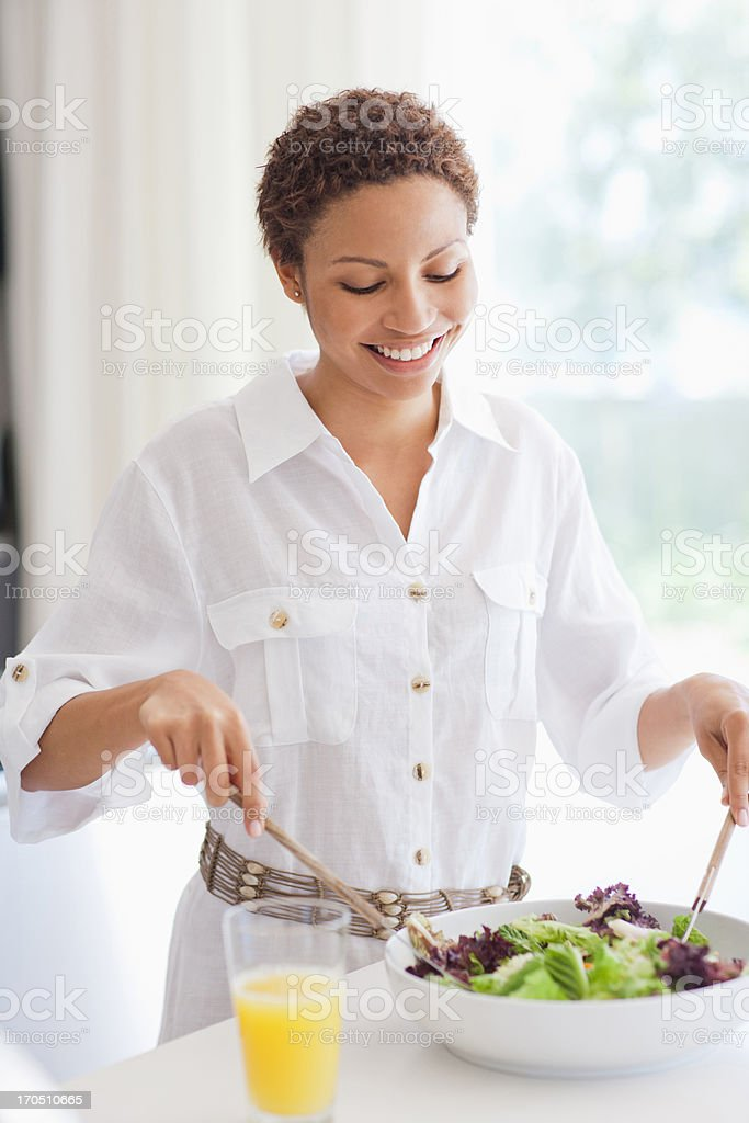 Woman tossing salad stock photo