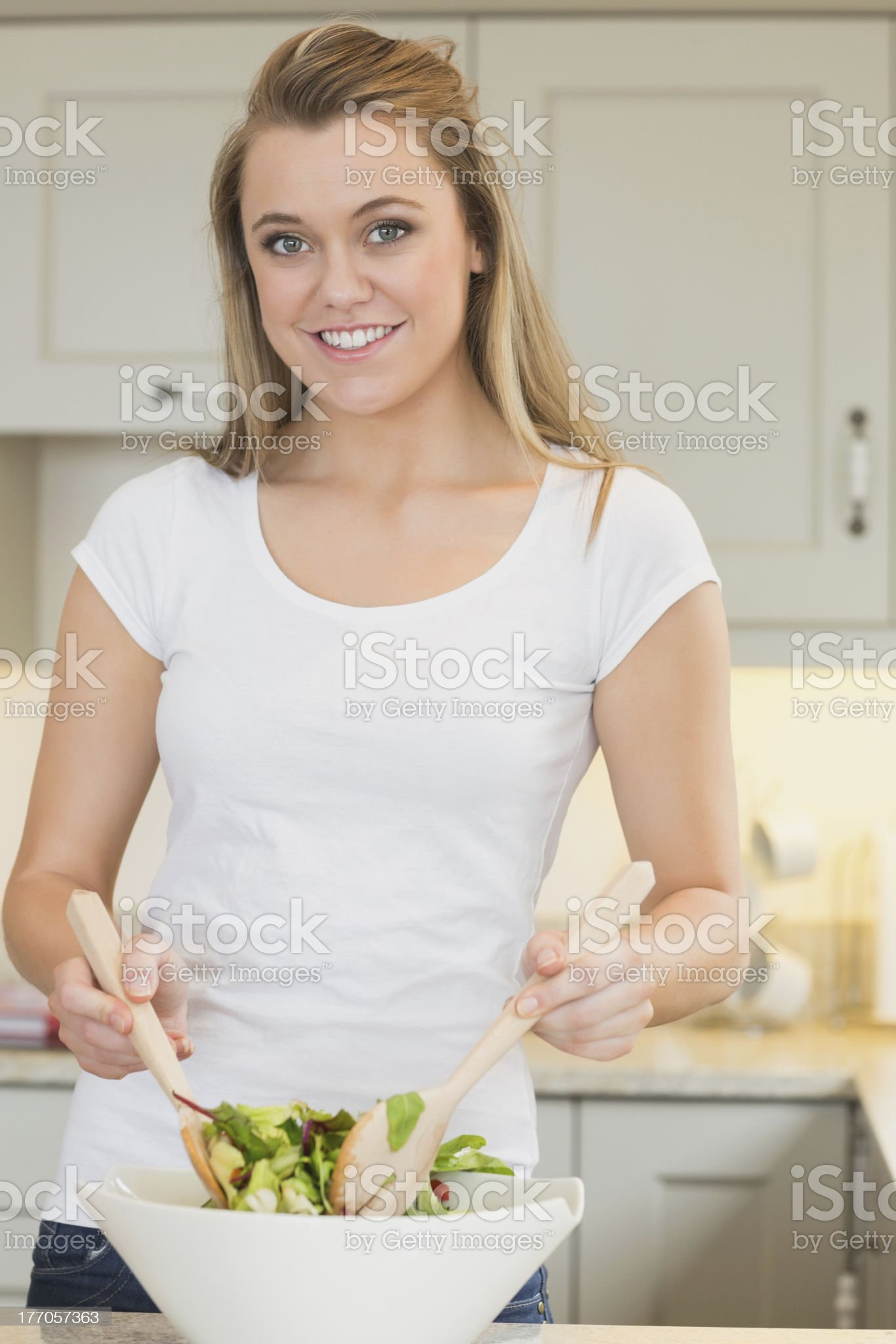 Woman tossing salad royalty-free stock photo