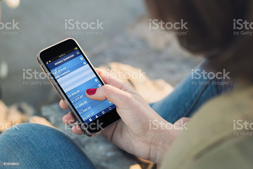 Woman touch the screen of her smartphone with mobile banking stock photo