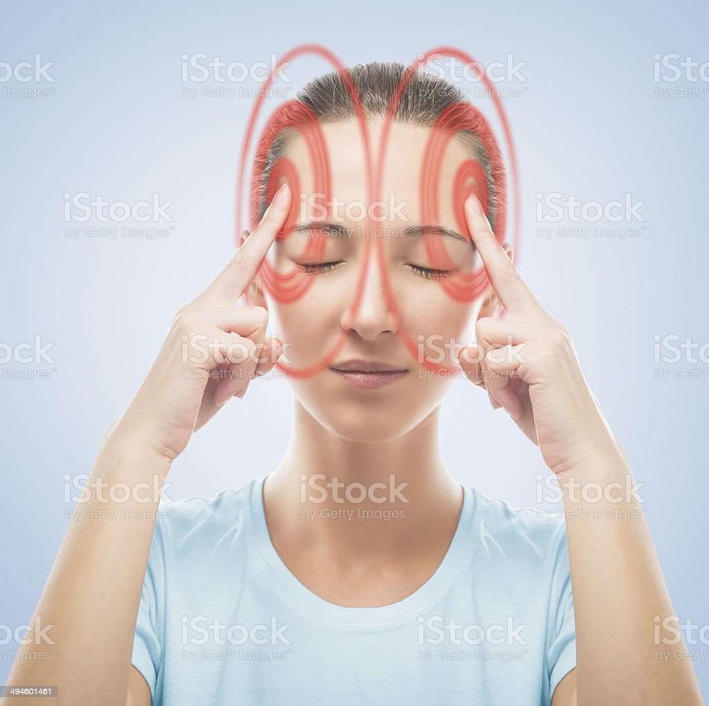Woman touches her head, temporal region of red color stock photo