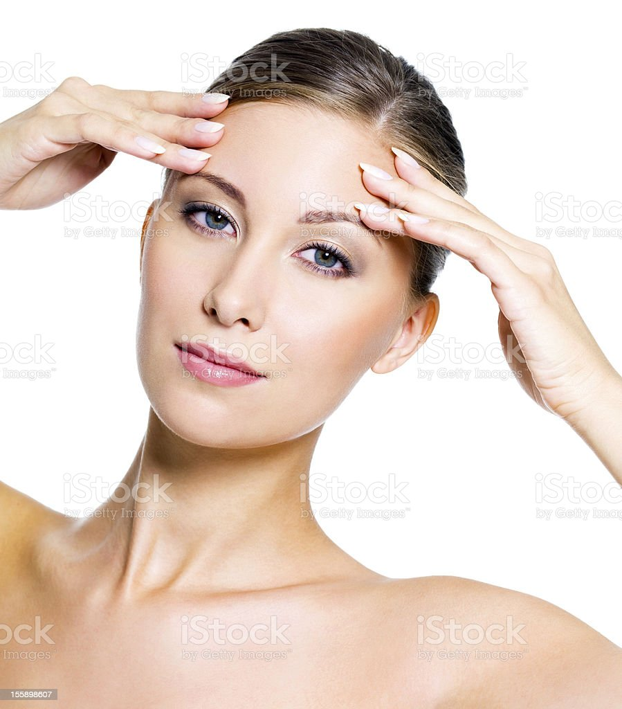 woman touching her forehead stock photo