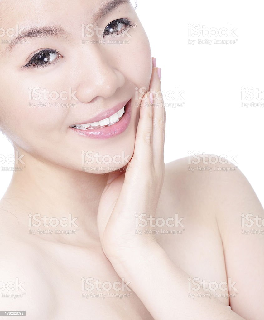 woman touching her pretty face with healthy skin royalty-free stock photo