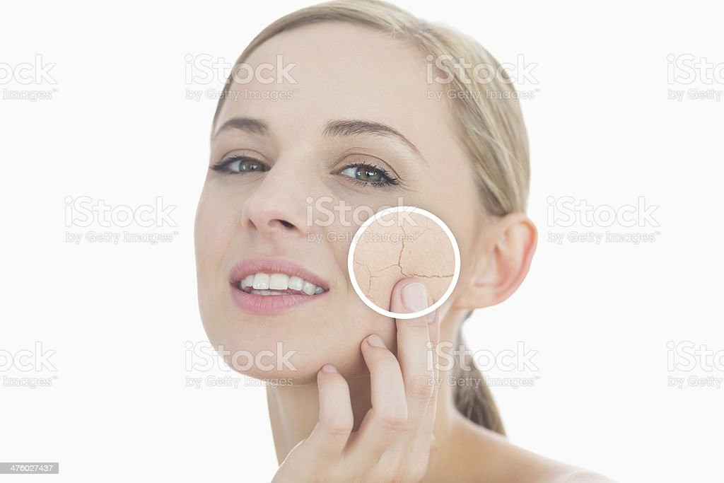 Woman touching own skin with close up of wrinkles royalty-free stock photo