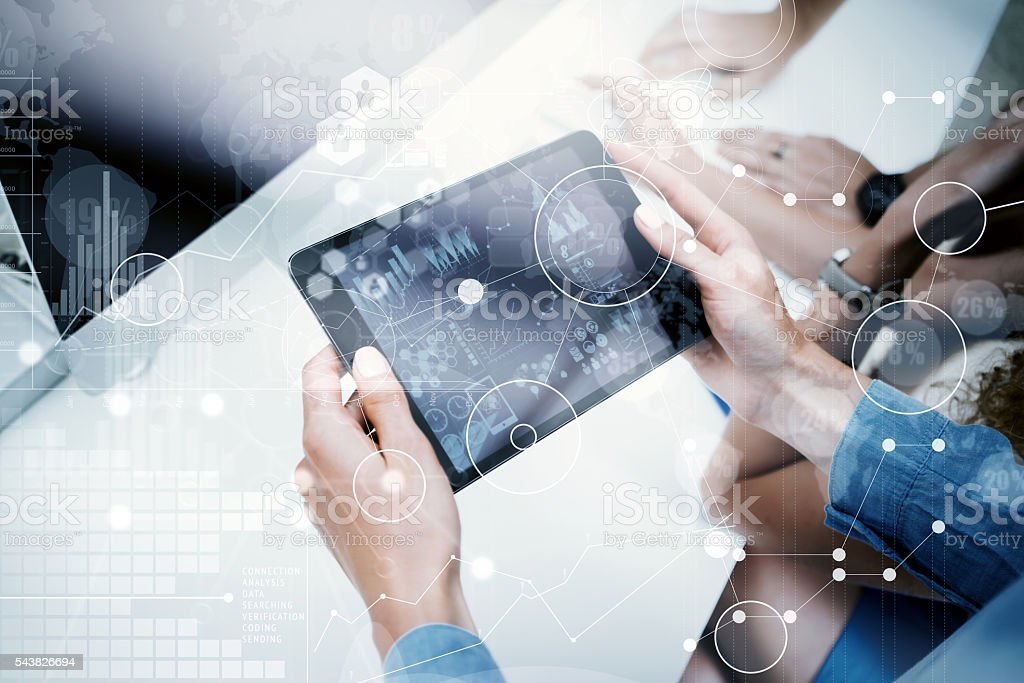 Woman Touching Screen Electronic Tablet Hand.Project Manager Researching Process stock photo