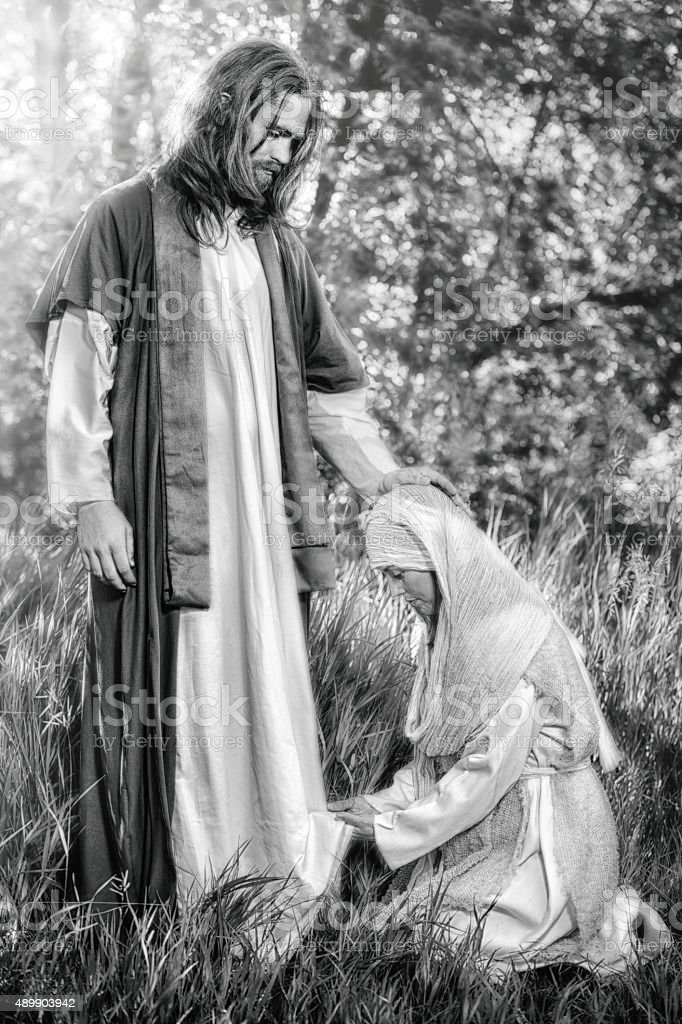 Woman Touching The Hem of Christ's Robe stock photo