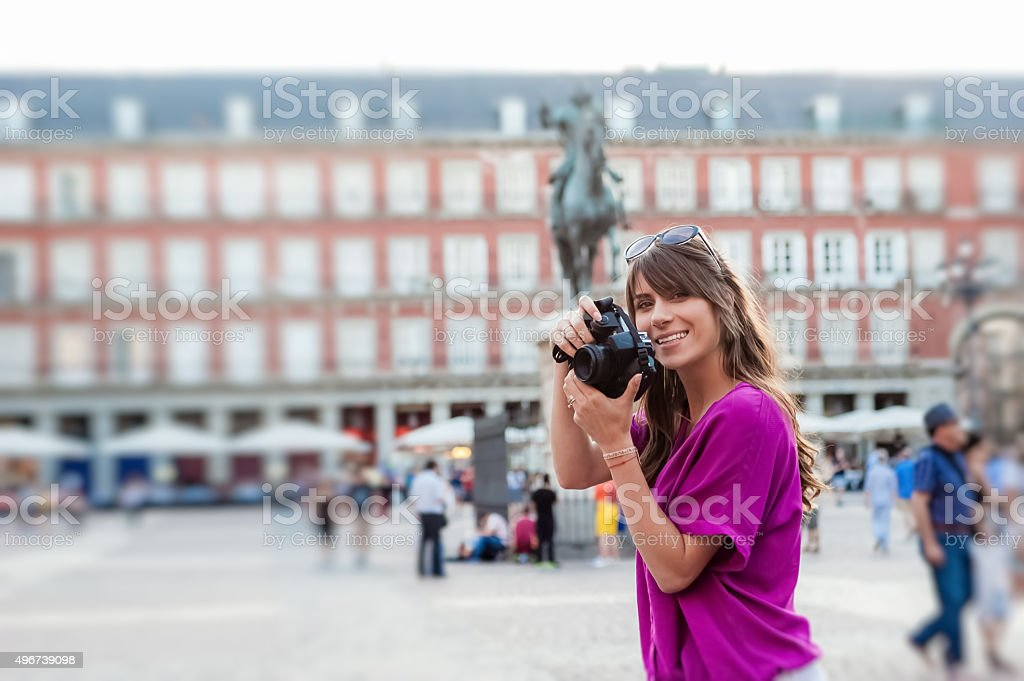 Woman tourist holding a photo camera stock photo