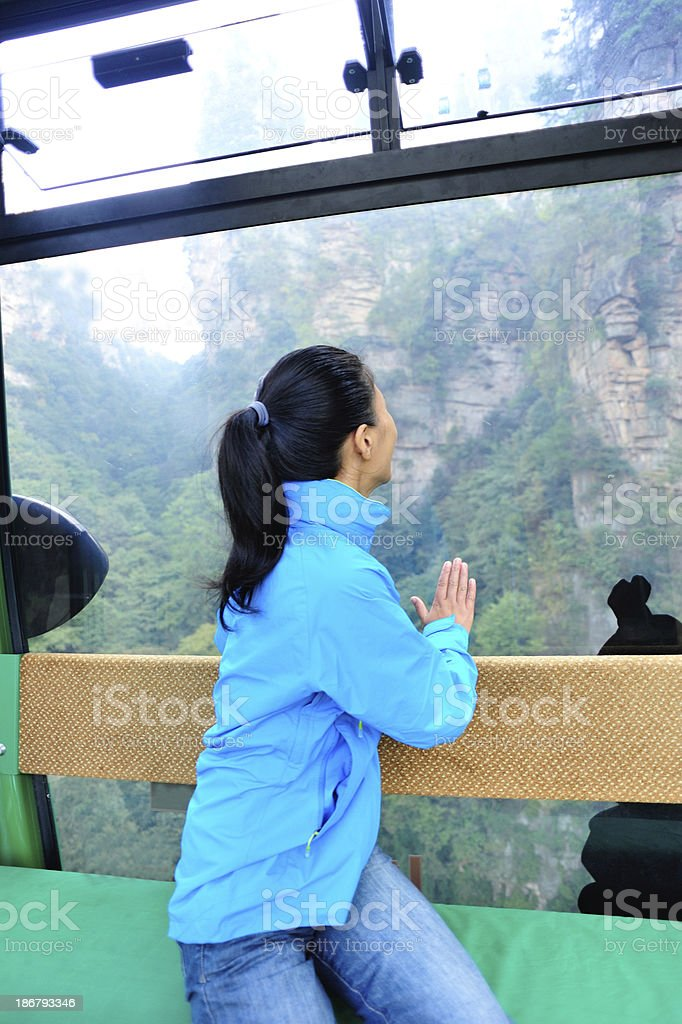 woman tourist in the cable car,zhangjiajie national forest park stock photo