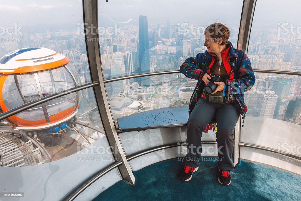 Woman tourist looking panorama from the cab, Guangzhou, Canton, China stock photo