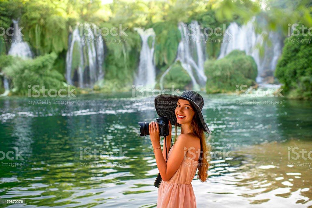 Woman tourist near Kravica waterfall stock photo
