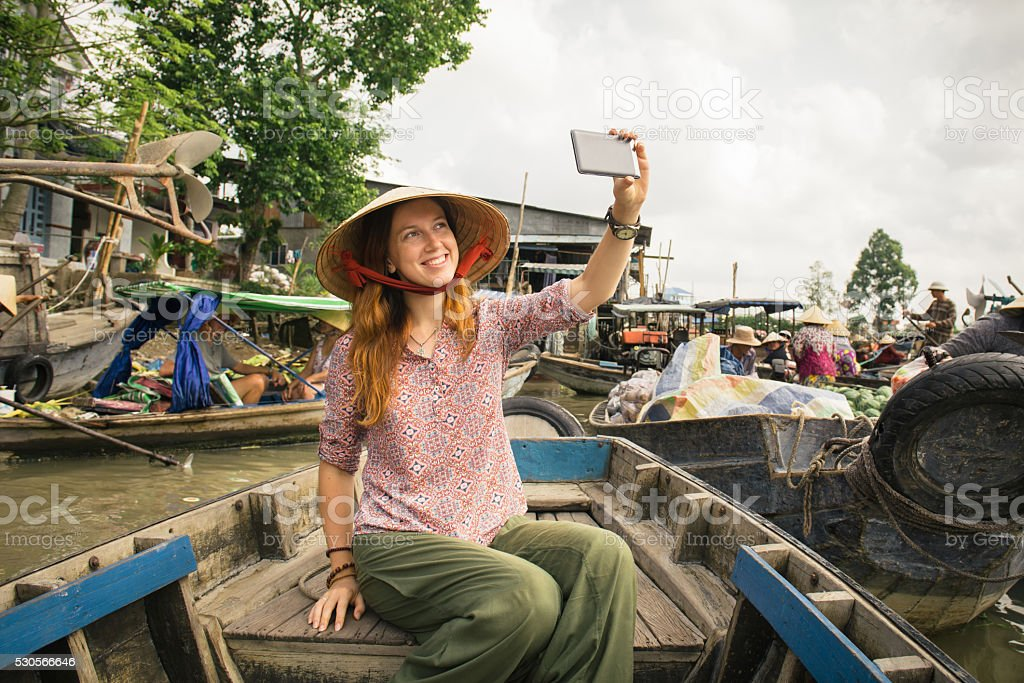 Woman tourist on floating market in Vietnam stock photo
