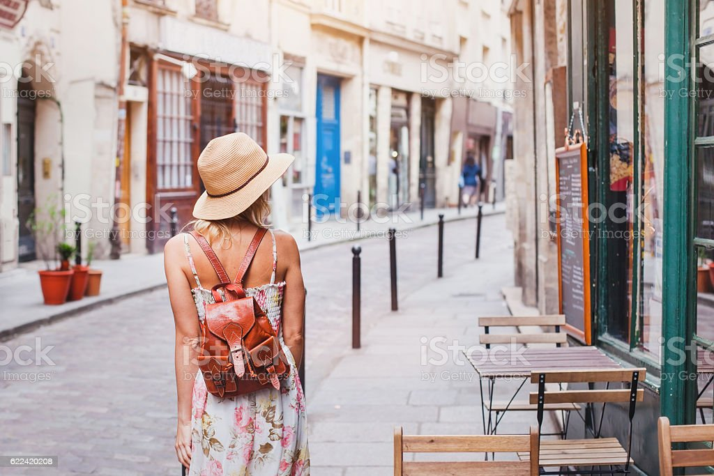 woman tourist on the street traveling in Europe stock photo
