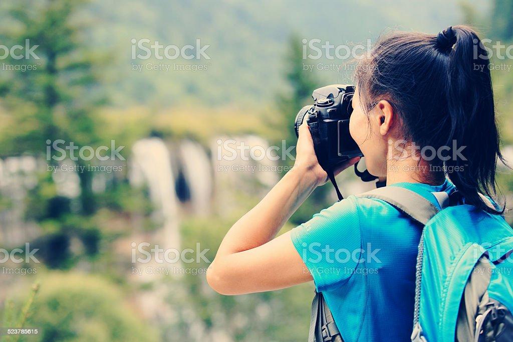 woman tourist taking photo with digital camera stock photo