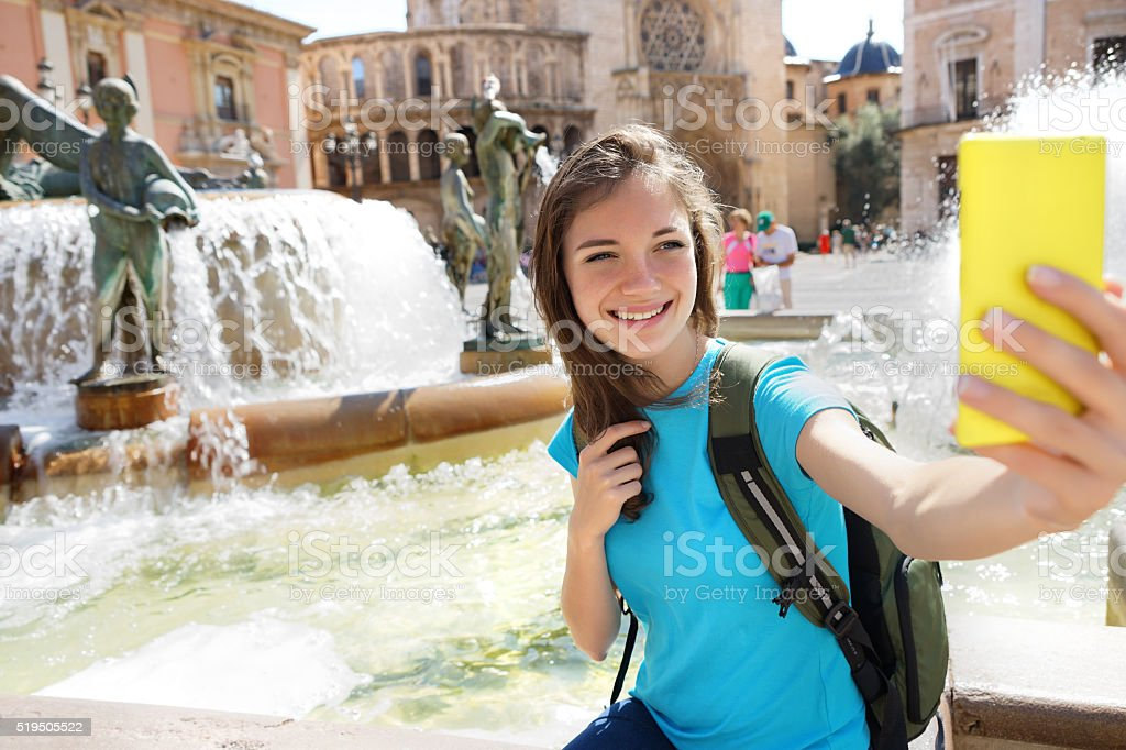 Woman tourist taking selfie pictures on Europe travel. stock photo