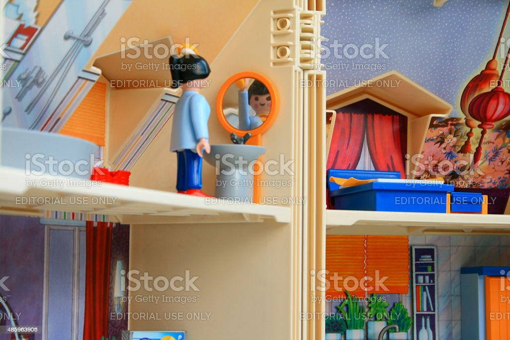 Woman toy alone staying at home doing everyday chores. stock photo