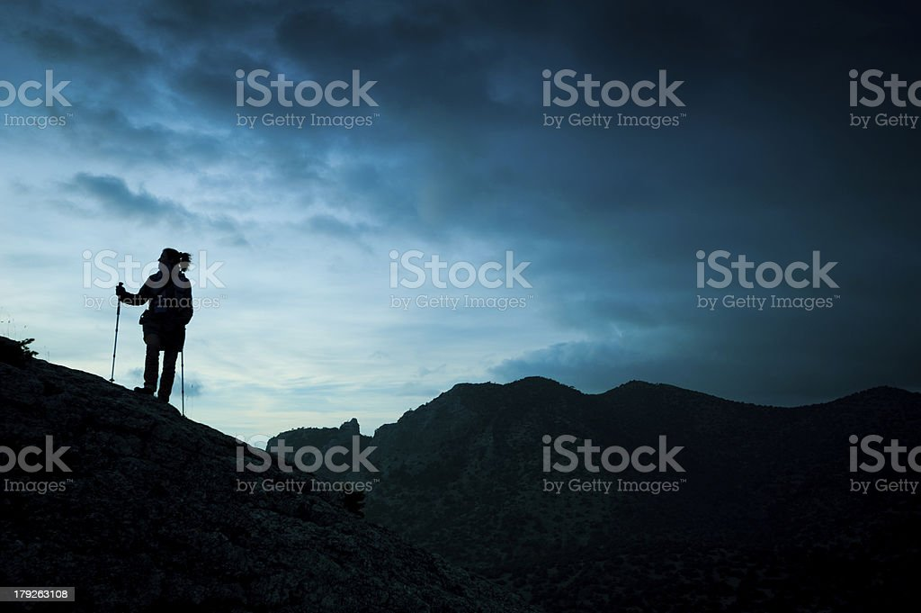 woman tracking sticks up on the mountain royalty-free stock photo