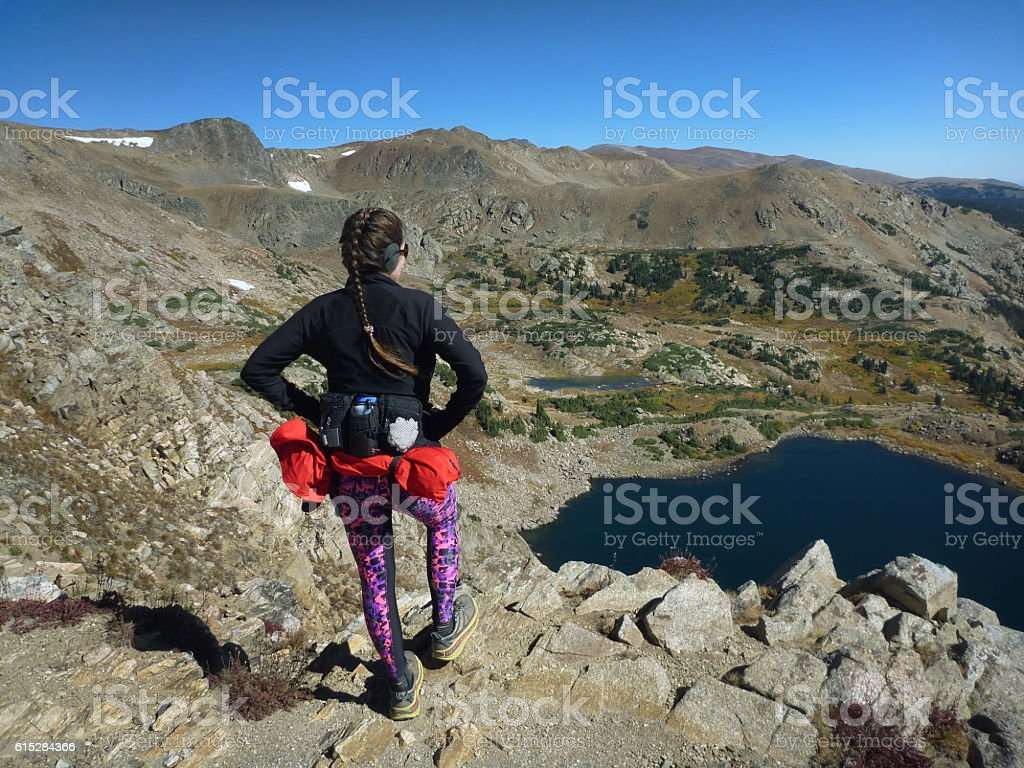 Woman trail runner Continental Divide King Lake Colorado Rocky Mountains stock photo