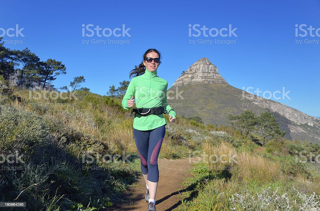 Woman trail running royalty-free stock photo