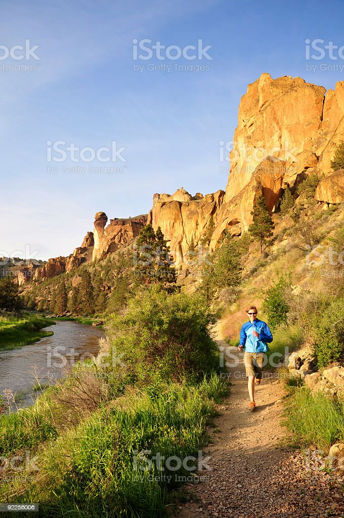 Woman trail running stock photo