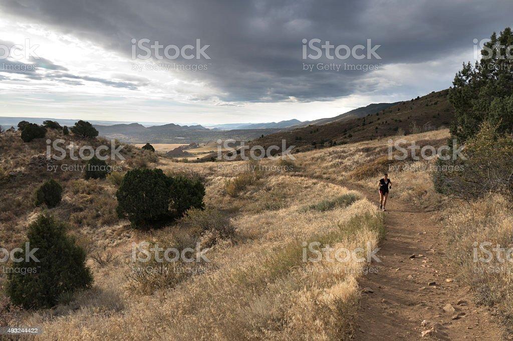Woman trail runs Mount Falcon Morrison Colorado Rocky Mountains stock photo