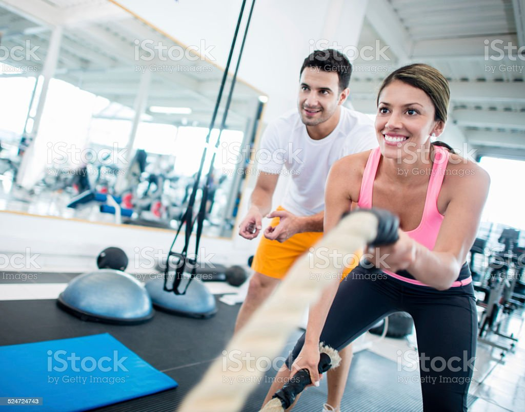 Woman training at the gym stock photo