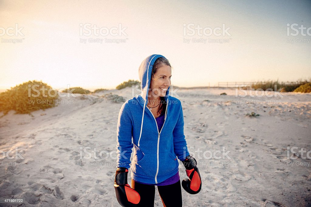 Woman training boxing on the beach stock photo