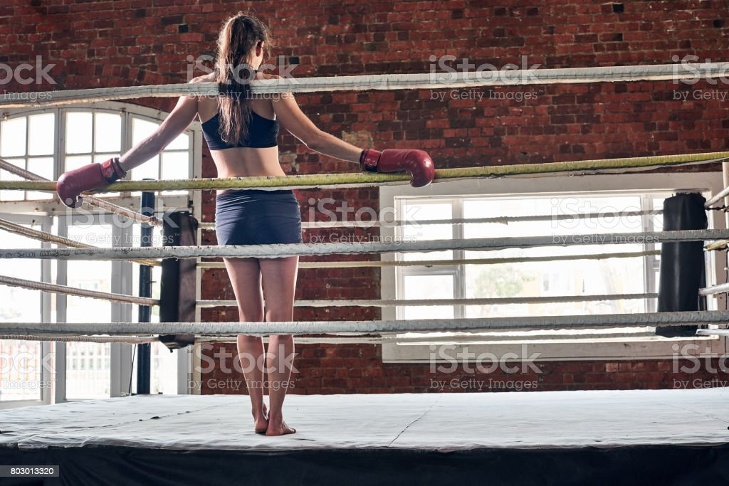 woman training gym boxing mma ring shadow boxing mixed martial arts fitness stock photo
