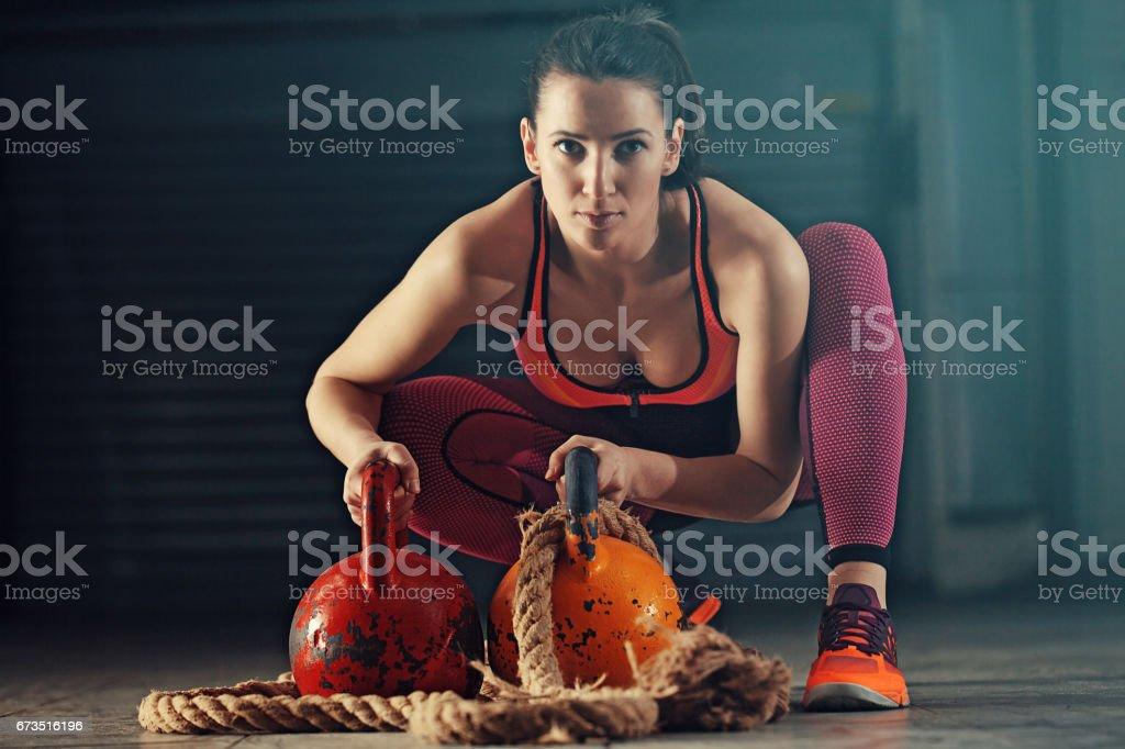 Woman training in garage stock photo