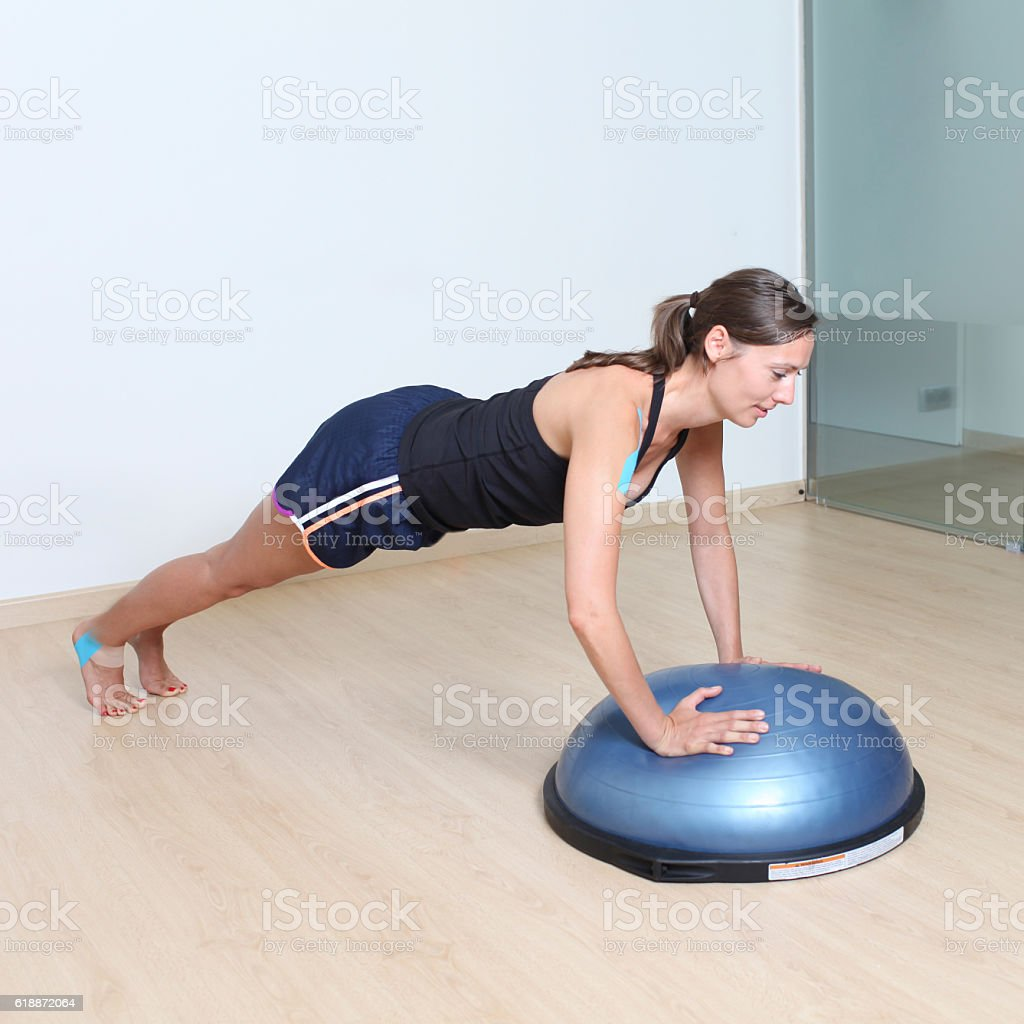 Woman training on a stability disc stock photo