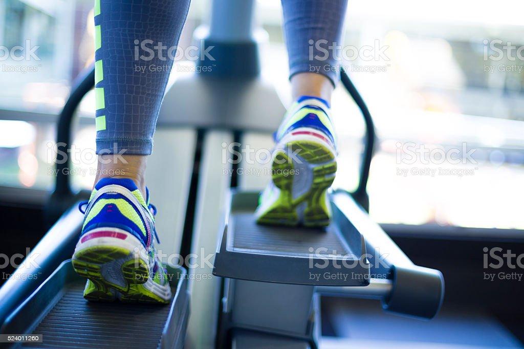 Woman training on ellipse stock photo