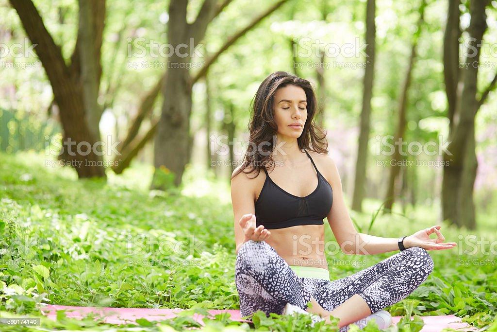 Woman training yoga and meditation at nature stock photo