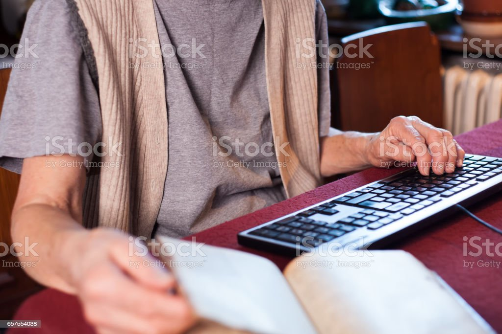 woman translating a book stock photo