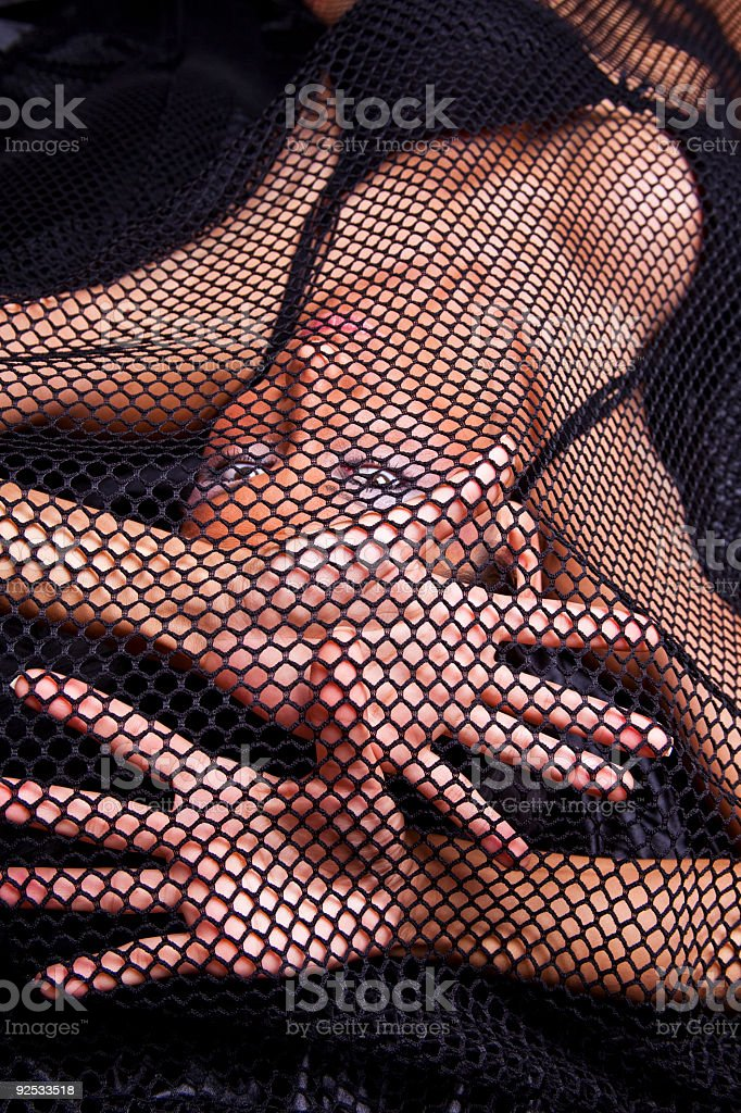 Woman Traped In Black Fishnet royalty-free stock photo