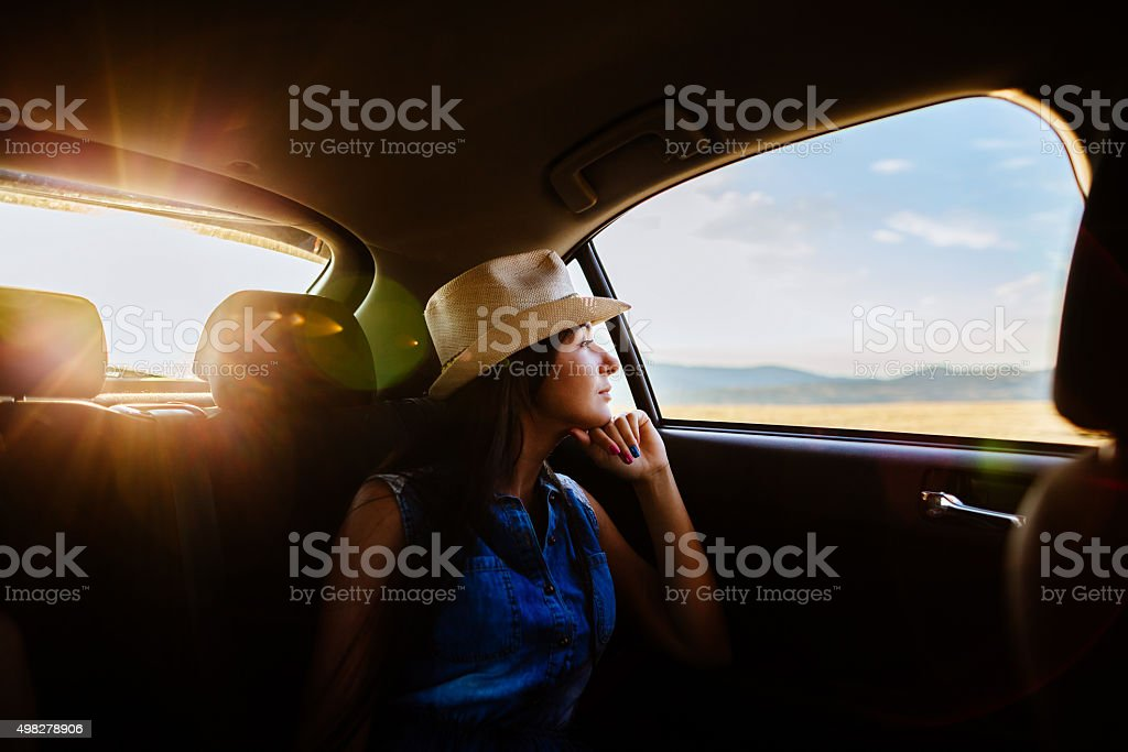 woman travel by car with sunlight and picturesque stock photo