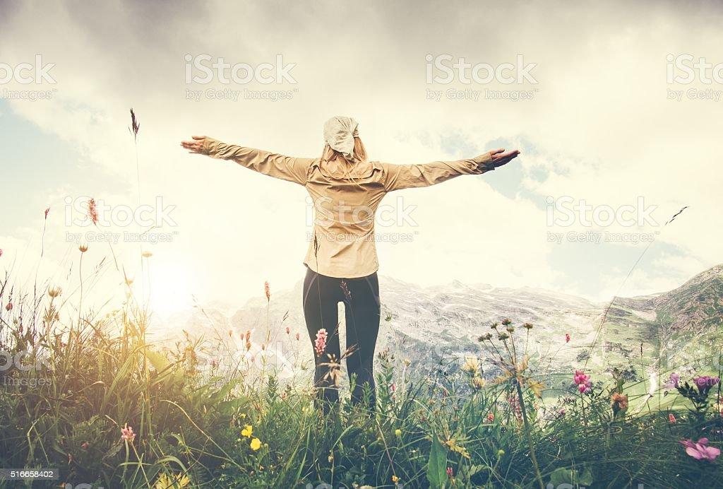 Woman Traveler hands raised hiking Travel Lifestyle concept stock photo