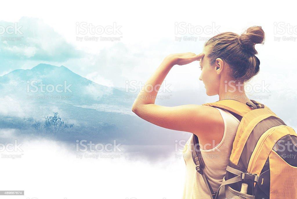 Woman traveler looking at Batur volcano. Indonesia stock photo