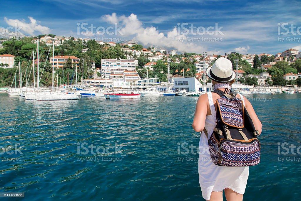 Woman traveler near sea harbor at summertime stock photo