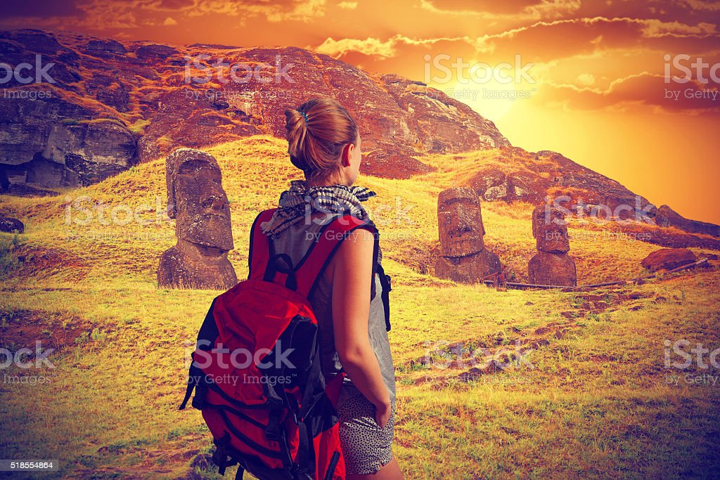 woman traveler with a backpack .Easter island stock photo