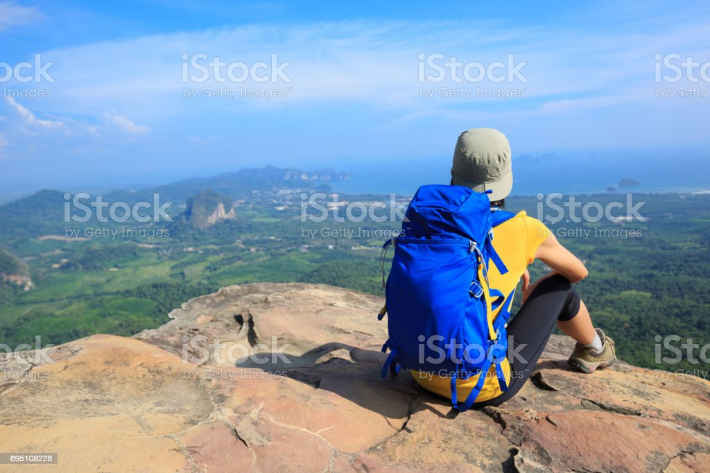 woman traveler with backpack hiking summer vacations outdoor beautiful seaside mountains on background stock photo