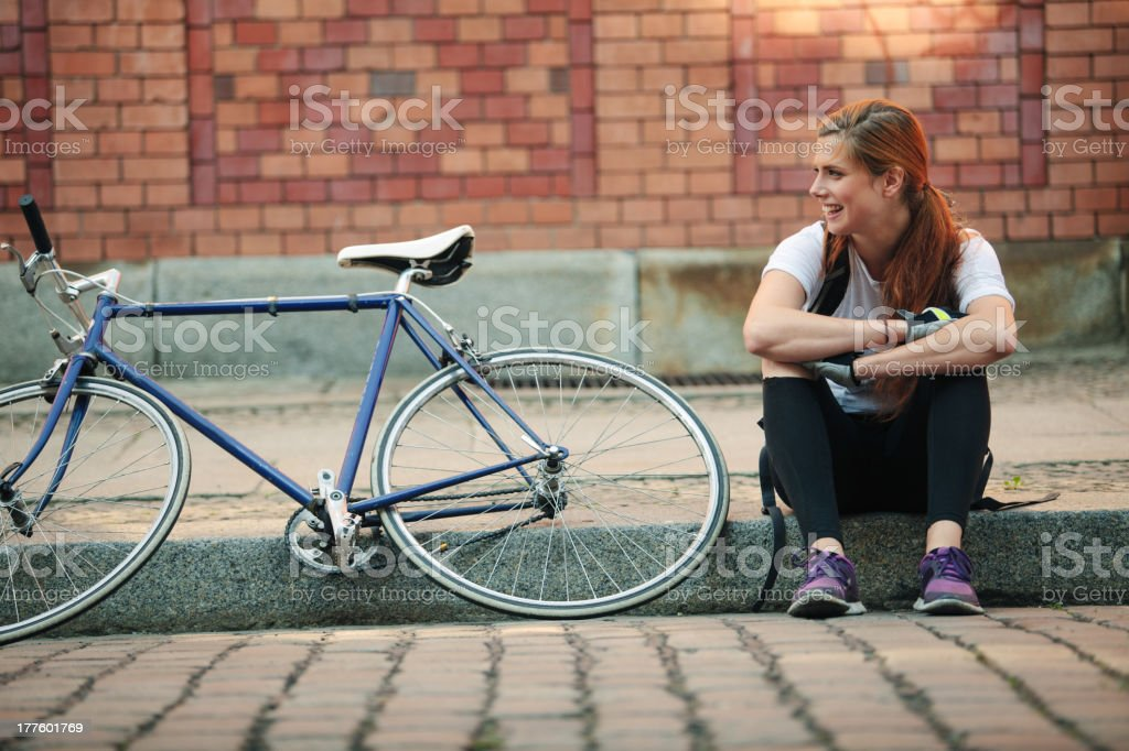 Woman traveling around the city on Bicycle stock photo