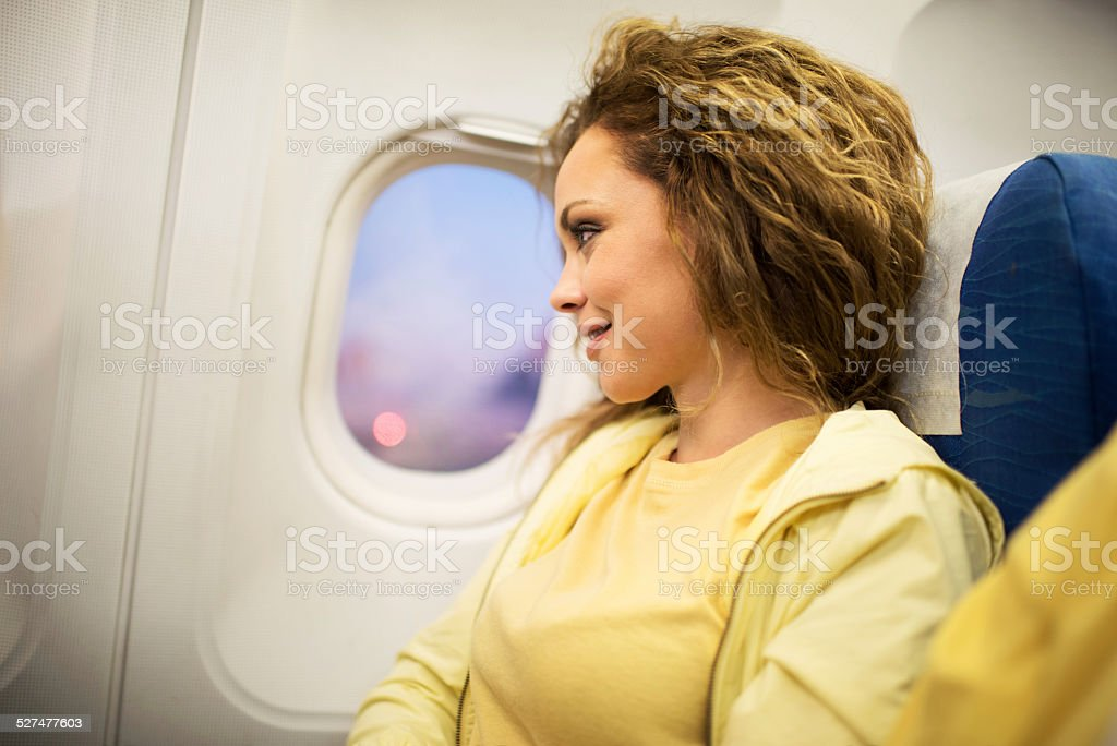 Woman traveling by plane. stock photo