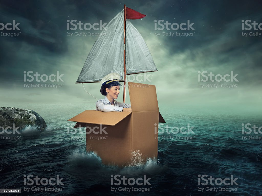 Woman traveling by water stock photo