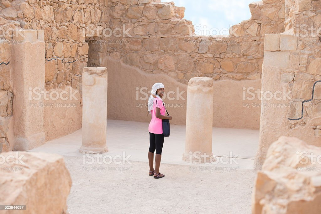 Woman traveling in Masada fortress. stock photo