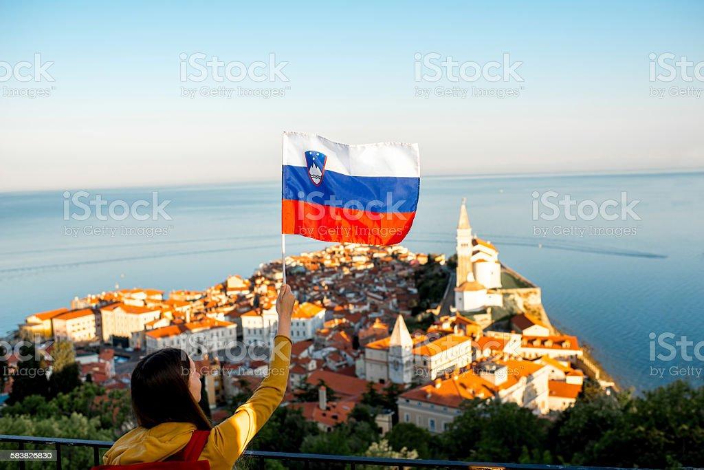 Woman traveling in Piran town stock photo