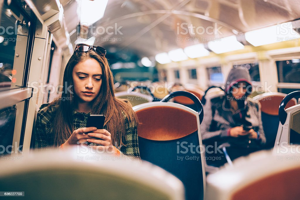 Woman traveling to work stock photo
