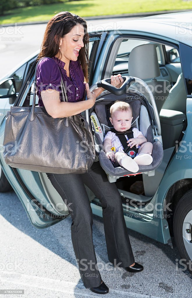 Woman traveling with baby royalty-free stock photo