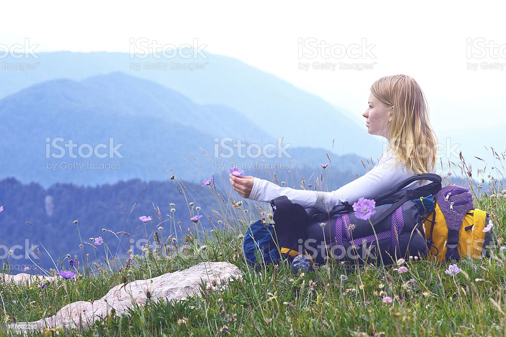 Woman Traveller relaxing with Mountains on Background royalty-free stock photo