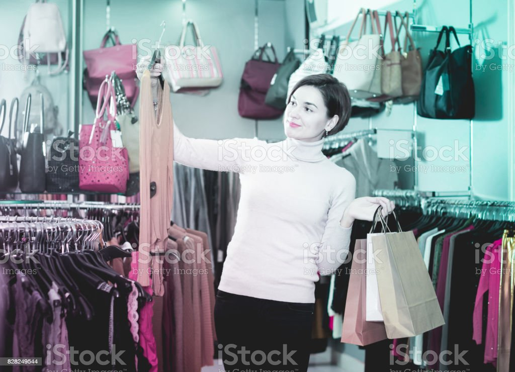 Woman  treats stylish blouse stock photo