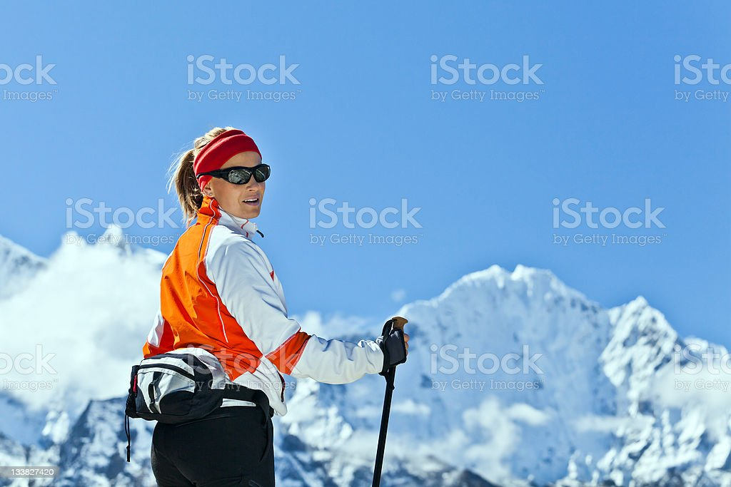 Woman trekking in Himalayas, Everest National Park royalty-free stock photo