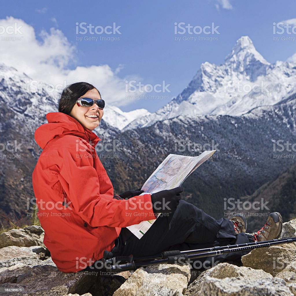 Woman trekking  in Himalayas, Nepal royalty-free stock photo