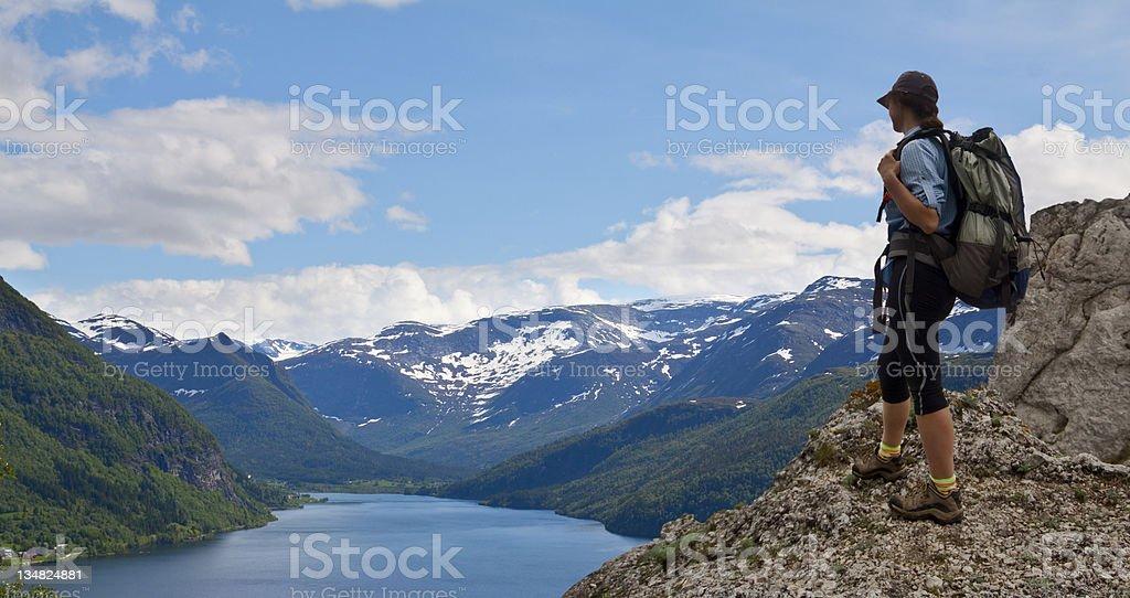 woman trekking in mountains stock photo